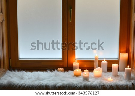 Candles on window sill - stock photo
