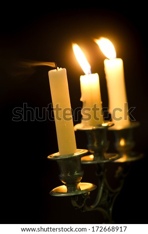 Candlestick with candles on - stock photo