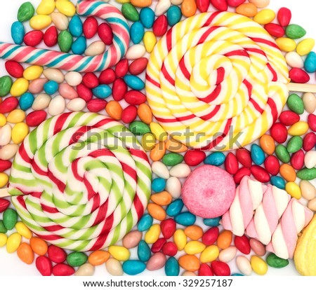 Candy background with big lolipops, bonbons and marshmallow - stock photo