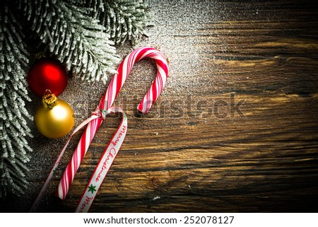 candy cane and other christmas decoration - stock photo