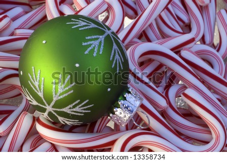 Candy Canes and Green Ornament - stock photo