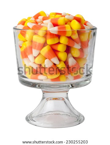 Candy corn in a dessert glass. This candy is a Halloween tradition and is given out as a treat to kids as they go door to door.  - stock photo