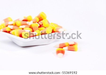 Candy corn on a little saucer - stock photo