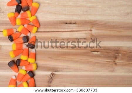 candy corn on wooden table background - stock photo