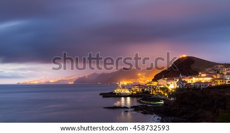 Canical at dusk/night, Funchal city in the background, Madeira, Portugal. Long exposure. - stock photo