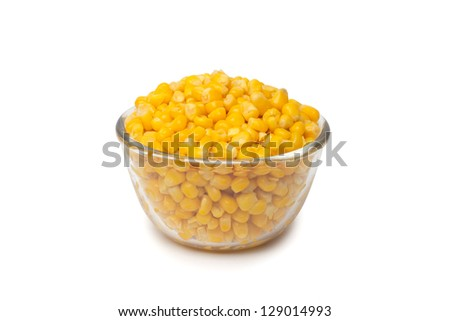 Canned corn in bowl isolated on white - stock photo