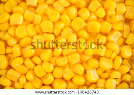 Canned corn with juice background - stock photo