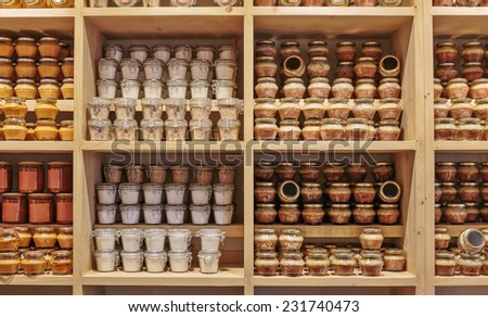 Canned products on the shelf in the store - stock photo
