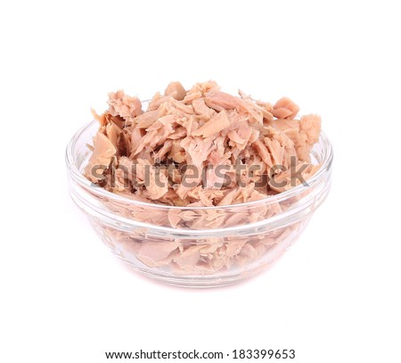 Canned tuna in glass bowl. Isolated on a white background. - stock photo