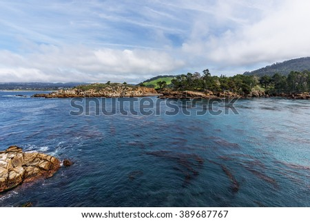 Cannery Point at Point Lobos State Natural Reserve, with aquamarine waters, rock formations, in the distance you see Coal Chute Point, along the rugged Big Sur coastline, near Carmel and Monterey, CA. - stock photo