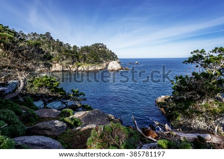 Cannery Point at Point Lobos State Natural Reserve, with aquamarine waters waves, & rock formations along the rugged Big Sur coastline, near Carmel and Monterey, CA. on the California Central Coast. - stock photo