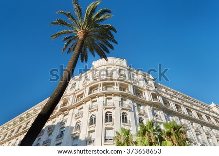 """CANNES, FRANCE - JULY 27, 2015: Luxury hotel """"Le Palais Miramar"""" (1929), located on famous Croisette boulevard in Cannes, French Riviera. Miramar is one of most famous hotel in Cannes. - stock photo"""