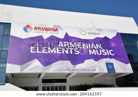 CANNES, FRANCE - JUNE 04: The poster for the MIDEM shown on june, 2015 in Cannes, France. The MIDEM is the leading international business event for the music, which takes place from 05 to 08 june . - stock photo