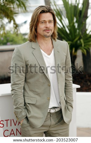 CANNES, FRANCE - MAY 22: Actor Brad Pitt poses during the photo-call of 'Killing them Softly' presented in competition at the 65th Cannes film festival on May 22, 2012 in Cannes. - stock photo