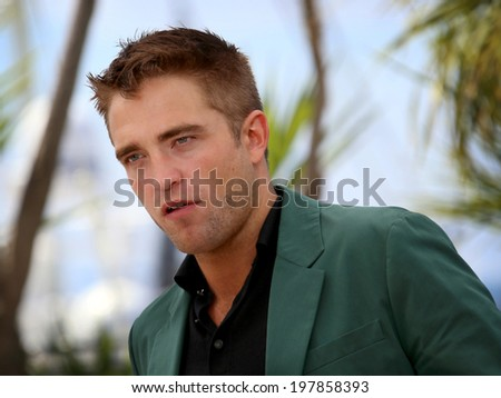 CANNES, FRANCE - MAY 18: Actor Robert Pattinson attends 'The Rover' photocall during the 67th Annual Cannes Film Festival on May 18, 2014 in Cannes, France - stock photo
