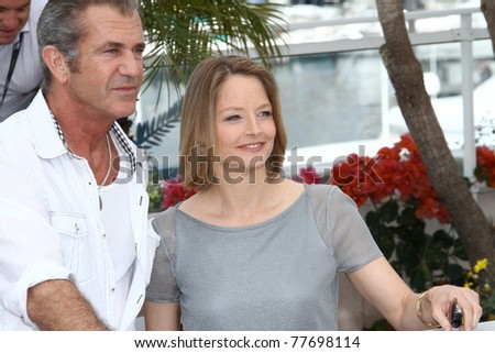 CANNES, FRANCE - MAY 18: Actors Jodie Foster and Mel Gibson attend 'The Beaver' Photocall at the Palais des Festivals during the 64th Cannes Film Festival on May 18, 2011 in Cannes, France - stock photo
