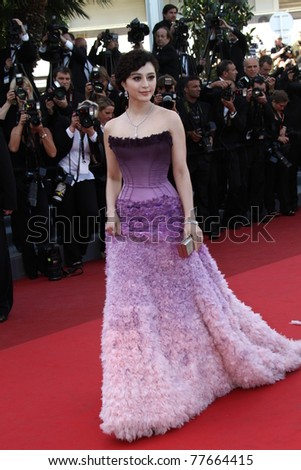 CANNES, FRANCE - MAY 15: Actress Fan Bingbing attends 'The Artist' premiere at the Palais des Festivals during the 64th Annual Cannes Film Festival on May 15, 2011 in Cannes, France. - stock photo