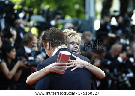CANNES, FRANCE - MAY 16: Actress Jane Fonda greets actor Alec Baldwin during the Opening Ceremony at 65th Annual Cannes Film Festival at Palais des Festivals on May 16, 2012 in Cannes, France.  - stock photo