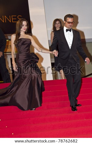 CANNES, FRANCE - MAY 16: Angelina Jolie, Brad Pitt depart 'The Tree Of Life' premiere during the 64th Annual Cannes Film Festival at Palais des Festivals on May 16, 2011 in Cannes, France. - stock photo