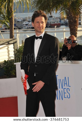 """CANNES, FRANCE - MAY 24, 2014: Bennett Miller, winner of Best Director for """"Foxcatcher"""", at the awards photocall at the 67th Festival de Cannes. - stock photo"""