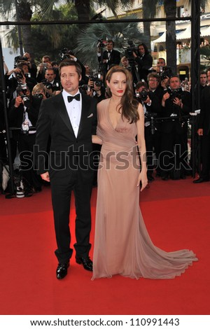 """CANNES, FRANCE - MAY 20, 2009: Brad Pitt & Angelina Jolie at the premiere of his new movie """"Inglourious Basterds"""" in competition at the 62nd Festival de Cannes. - stock photo"""
