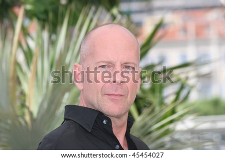 CANNES, FRANCE - MAY 21: Bruce Willis attends a photocall promoting the film 'Over The Hedge' at the Palais during the 59th International Cannes Film Festival on May 21, 2006 in Cannes, France - stock photo