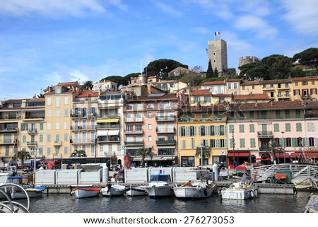 CANNES, FRANCE - MAY 1, 2015: Cannes cityscape viewed from the old harbour on May 1, 2015 in Cannes, France. - stock photo