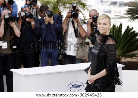 CANNES, FRANCE- MAY 14: Charlize Theron attends 'Mad Max Fury Road' photo-call during the 68th Cannes Film Festival on May 14, 2015 in Cannes, France. - stock photo