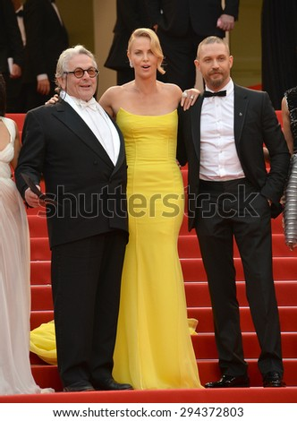 "CANNES, FRANCE - MAY 14, 2015: Charlize Theron, Tom Hardy & director George Miller at the gala premiere of their movie ""Mad Max: Fury Road"" at the 68th Festival de Cannes.