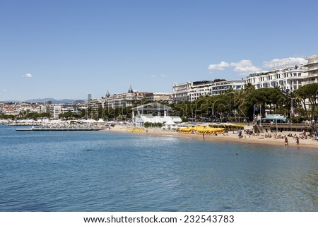 CANNES, FRANCE - MAY 14, 2014: City with the population of approx. 80 thousands citizens located in the French Riviera, busy tourist destination, famous of its beaches and annual Cannes Film Festival - stock photo