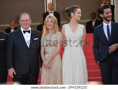 "CANNES, FRANCE - MAY 18, 2015: Disney/Pixar boss John Lasseter with actresses Melanie Laurent, Charlotte Le Bon & actor Pierre Niney at the premiere of ""Inside Out"" at the 68th Festival de Cannes.  - stock photo"