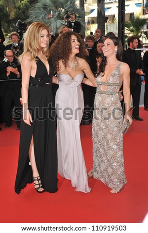 "CANNES, FRANCE - MAY 17, 2009: Doutzen Kroes (left), Afef Jnifen & Evangeline Lilly at the premiere of ""Vengeance"" in competition at the 62nd Festival de Cannes. - stock photo"