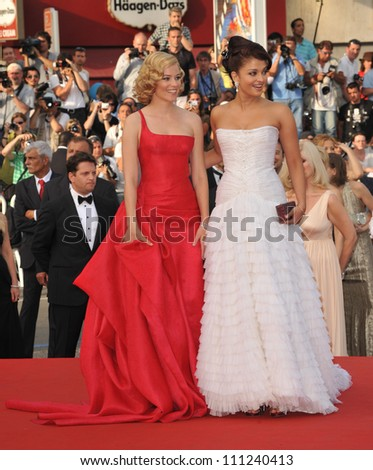 """CANNES, FRANCE - MAY 13, 2009: Elizabeth Banks & Aishwarya Rai (in white) at the opening night gala screening of """"Up"""" at the 62nd Festival de Cannes. - stock photo"""