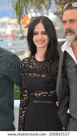 "CANNES, FRANCE - MAY 17, 2014: Eva Green & Jeffrey Dean Morgan at photo call for their movie ""The Salvation"" at the 67th Festival de Cannes.  - stock photo"