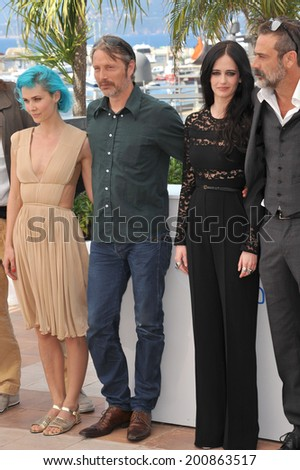 "CANNES, FRANCE - MAY 17, 2014: Eva Green, Nanna Oland Fabricius, Mads Mikkelsen (left) & Jeffrey Dean Morgan at photo call for their movie ""The Salvation"" at the 67th Festival de Cannes.  - stock photo"