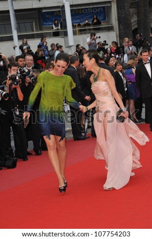 "CANNES, FRANCE - MAY 15, 2010: Evangeline Lilly & Michelle Yeoh at the premiere of Woody Allen's ""You Will Meet A Tall Dark Stranger"" at the 63rd Festival de Cannes. - stock photo"