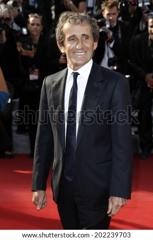 CANNES, FRANCE - MAY 26: French race car driver Alain Prost attends the 'Mud' Premiere during the 65th Annual Cannes Film Festival at Palais des Festivals on May 26, 2012 in Cannes, France - stock photo