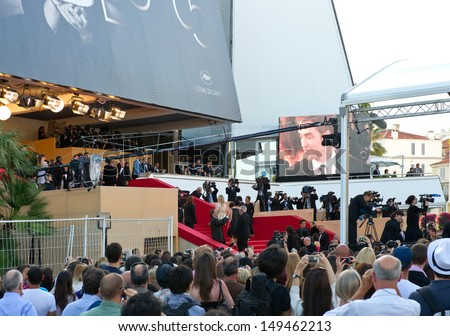 CANNES, FRANCE - MAY 23: Guests and Stars walk to the 'Cosmopolis' premiere during the 65th Annual Cannes Film Festival at Palais des Festivals on May 23, 2012 in Cannes, France - stock photo