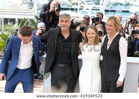 CANNES, FRANCE - MAY 12: Jack O'Connell, George Clooney, Jodie Foster and Julia Roberts, 'Money Monster' Photocall, 69th Cannes Film Festival at Palais des Festivals on May 12, 2016 in Cannes, France. - stock photo