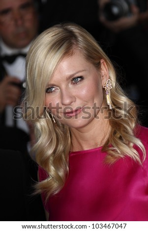 CANNES, FRANCE - MAY 23: Kirsten Dunst attends the 'On The Road' Premiere during the 65th Cannes Film Festival at Palais des Festivals on May 23, 2012 in Cannes, France. - stock photo