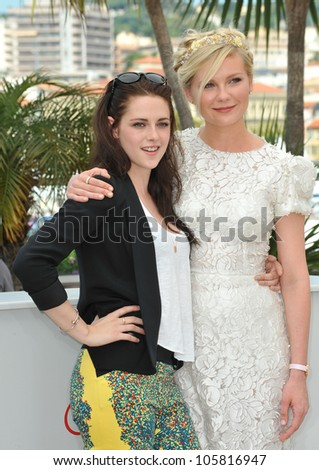 """CANNES, FRANCE - MAY 23, 2012: Kristen Stewart (left) & Kirsten Dunst at the photocall for their new movie """"On The Road"""" in Cannes. May 23, 2012  Cannes, France - stock photo"""