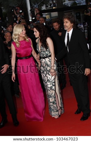 CANNES, FRANCE - MAY 23: Kristen Stewart, Walter Salles,Kirsten Dunst  attend the 'On The Road' Premiere during the 65th Cannes Film Festival at Palais des Festivals on May 23, 2012 in Cannes, France. - stock photo