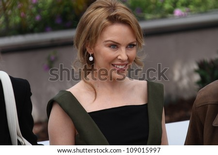 CANNES, FRANCE - MAY 23: Kylie Minogue poses at the 'Holy Motors' Photocall during the 65th Annual Cannes Film Festival at Palais des Festivals on May 23, 2012 in Cannes, France. - stock photo
