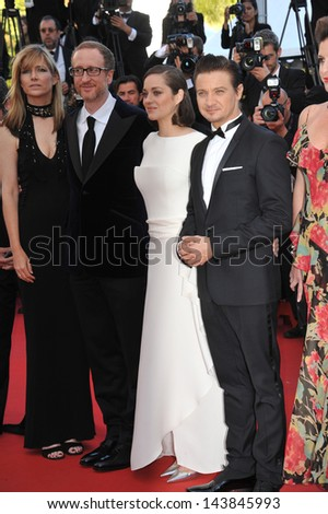 "CANNES, FRANCE - MAY 23, 2013: Marion Cotillard, Jeremy Renner & director James Gray at the premiere of ""The Immigrant"" at the 66th Festival de Cannes.  - stock photo"