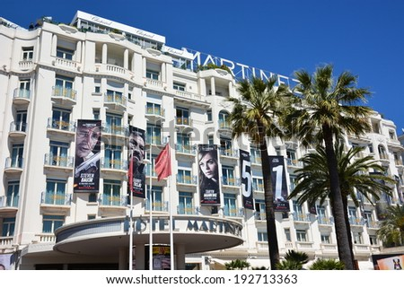 CANNES, FRANCE- MAY 14: Martinez hotel shown on may 14, 2014 in cannes, France. The facade of this luxurious hotel is decorated for the 67th International Film Festival rewarded by the golden palm.  - stock photo
