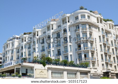CANNES, FRANCE -  MAY 26: Martinez palace facade shown on May 26, 2012 in Cannes, France. Martinez hotel is a luxury hotel containing 409 rooms, located on the famous festival film town. - stock photo