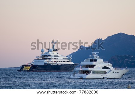 """CANNES, FRANCE - MAY 15:  superyacht """"octopus"""" of tycoon paul allen is  in cannes' bay  during the 64th Annual Cannes Film Festival on May 15, 2011 in Cannes, France. - stock photo"""