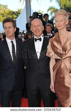 """CANNES, FRANCE - MAY 16, 2012: Tilda Swinton with Bruce Willis & Edward Norton (left) at the premiere of their movie """"Moonrise Kingdom"""" at the 65th Festival de Cannes. May 16, 2012  Cannes, France - stock photo"""