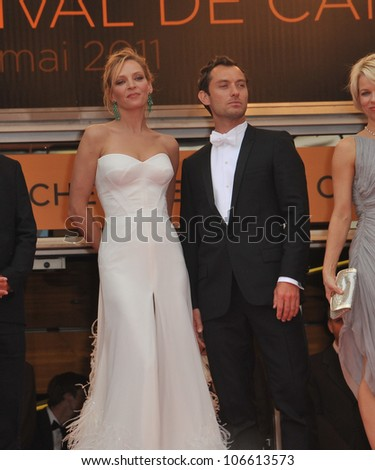 """CANNES, FRANCE - MAY 11, 2011: Uma Thurman & Jude Law at the gala premiere for """"Midnight in Paris"""" the opening film at the 64th Festival de Cannes. May 11, 2011  Cannes, France - stock photo"""