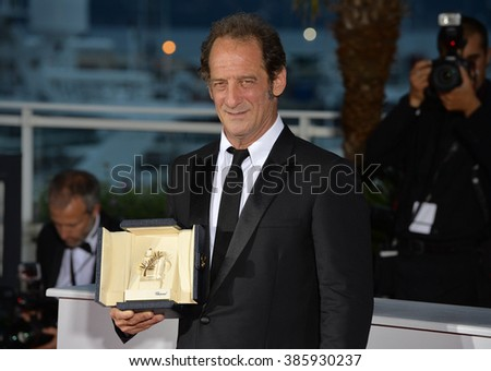 CANNES, FRANCE - MAY 24, 2015: Vincent Lindon - winner of Best Actor award at the winners' photocall at the 68th Festival de Cannes. - stock photo